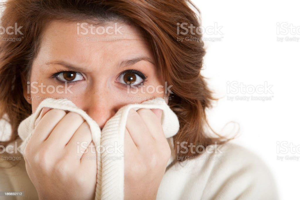 Woman Covering Her Mouth with Sweater royalty-free stock photo