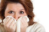 istock Woman Covering Her Mouth with Sweater 186850112