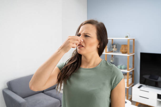 Woman Covering Her Nose From Bad Smell stock photo