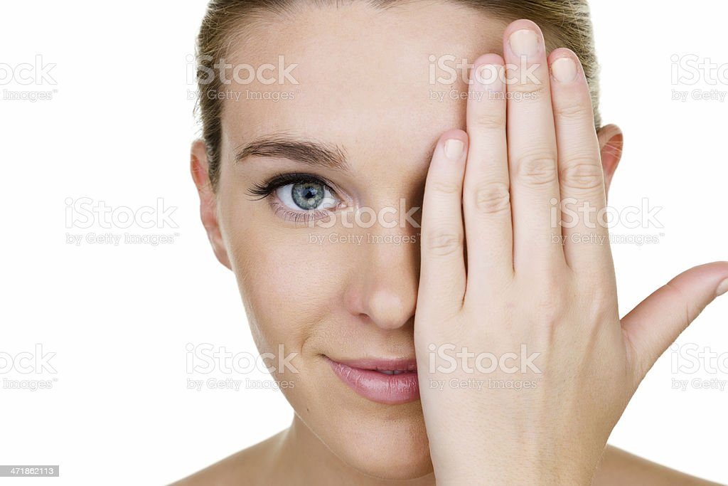 Woman covering one eye royalty-free stock photo