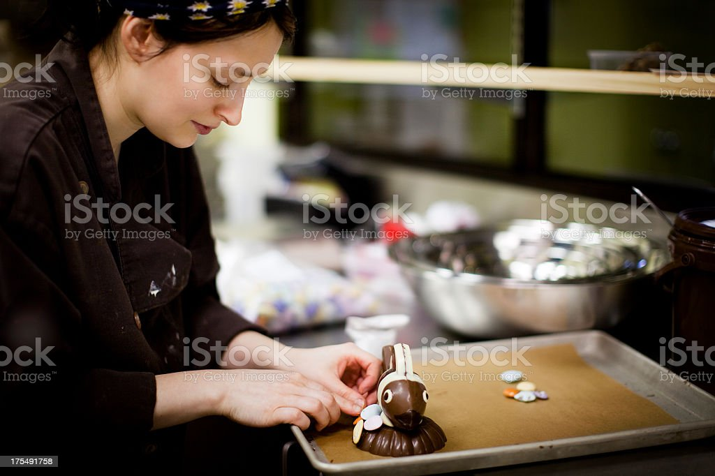 Woman crafting an animal out of chocolate stock photo