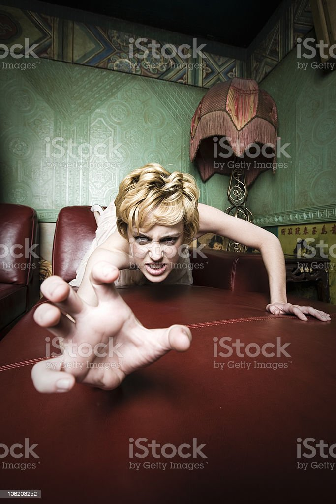 Woman Crawling on Leather Chair royalty-free stock photo