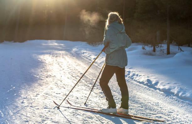 Woman cross country skiing stock photo