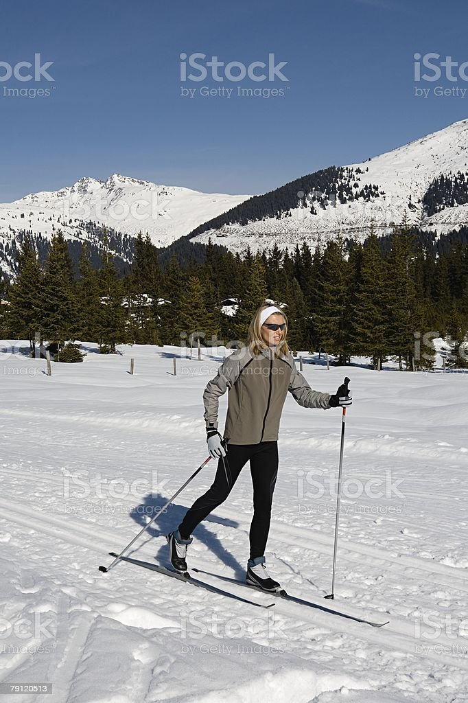 Woman cross country skiing 免版稅 stock photo