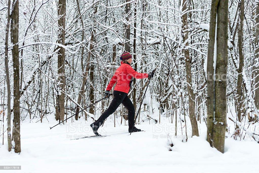 Woman cross-country skiing, snow, winter sport. stock photo