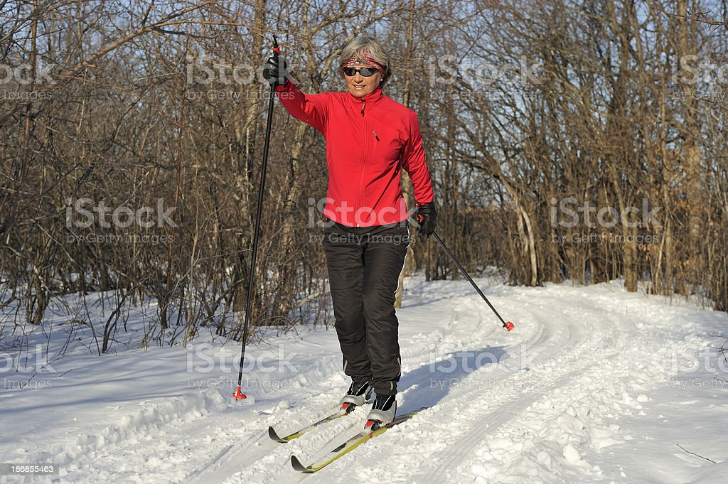 Woman skiing on a beautiful day.