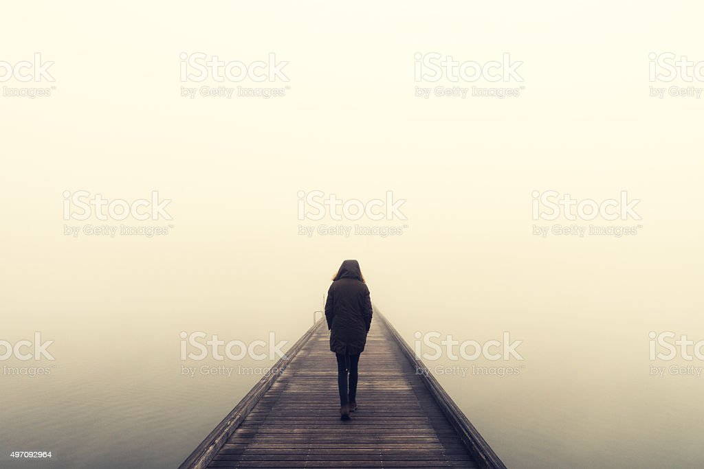 Woman Crossing The Bridge stock photo