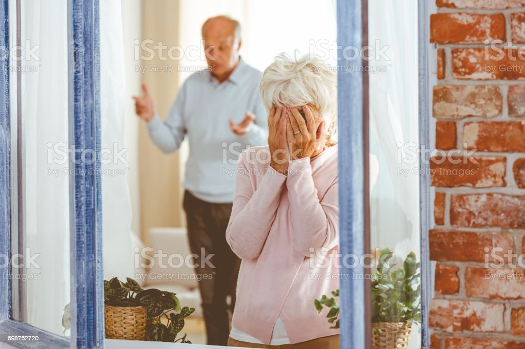Woman crying during argument stock photo