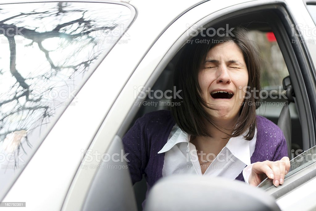 Woman crying in a traffic jam royalty-free stock photo