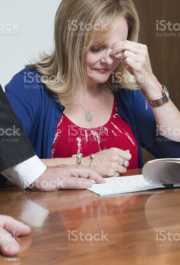 Woman Crying While Being Shown a Document royalty-free stock photo
