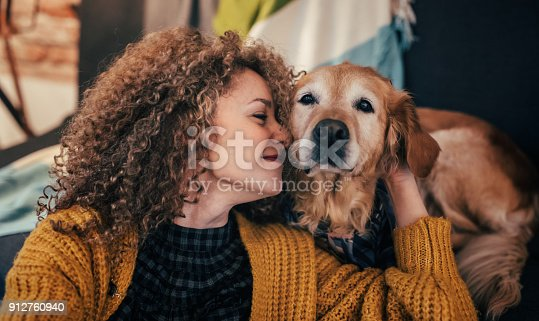 istock Woman cuddling with her dog 912760940