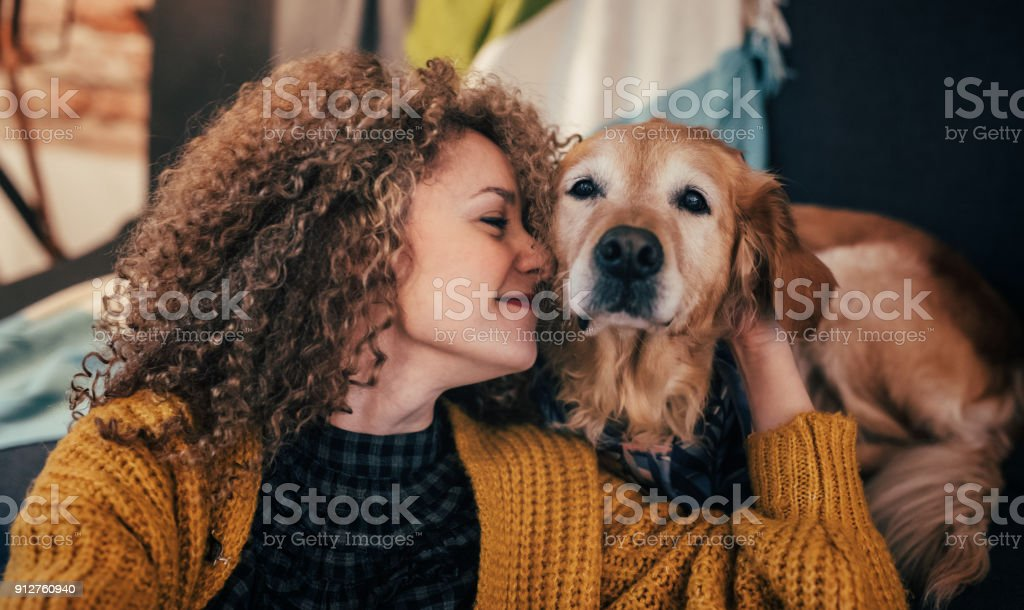 Woman cuddling with her dog stock photo