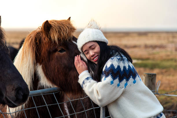 Woman cuddling with icelandic horse on iceland road trip picture id1096762622?b=1&k=6&m=1096762622&s=612x612&w=0&h=zipciifsq0 kuwpvhfa5srarydt9hbibgatlliztg7w=