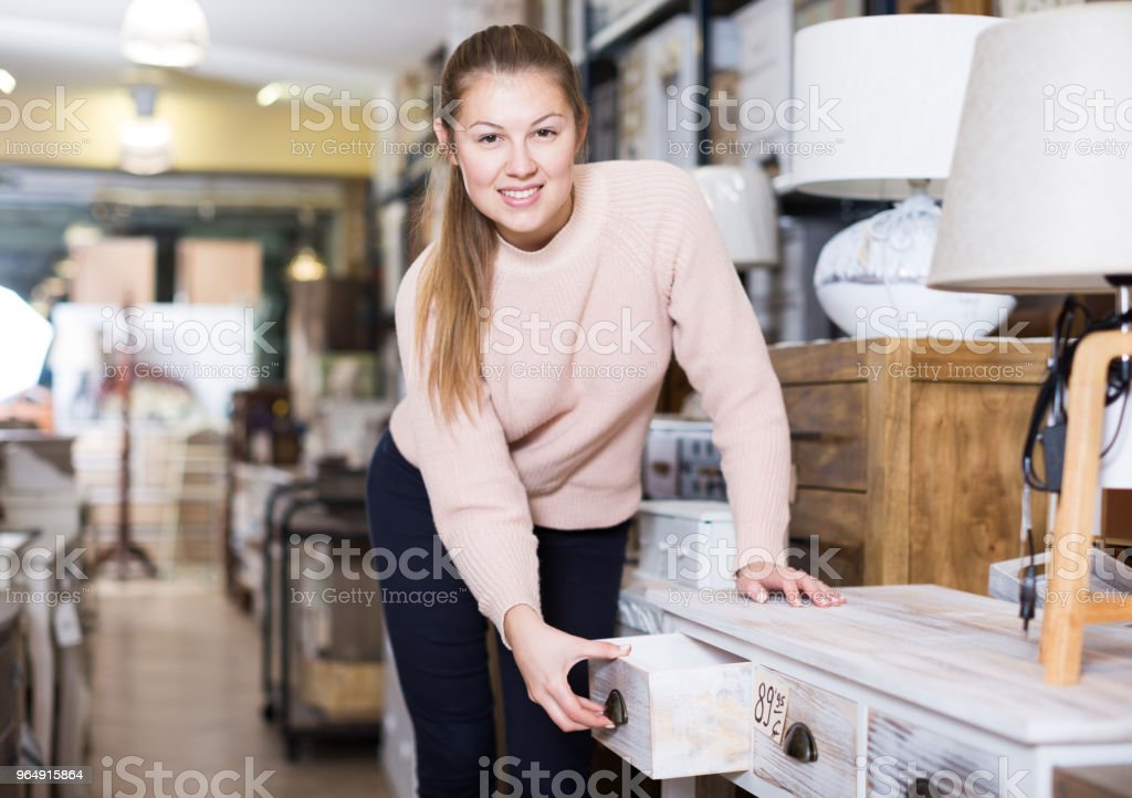 woman customer touching table with drawers royalty-free stock photo