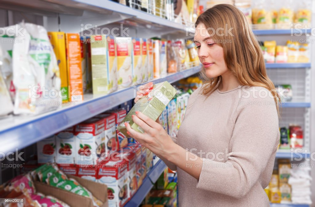 Woman customer with assortment of grocery food shop - Royalty-free Adult Stock Photo
