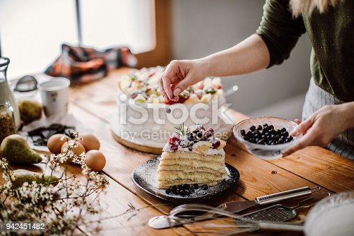 Woman cut a piece of cake for the birthday celebrant