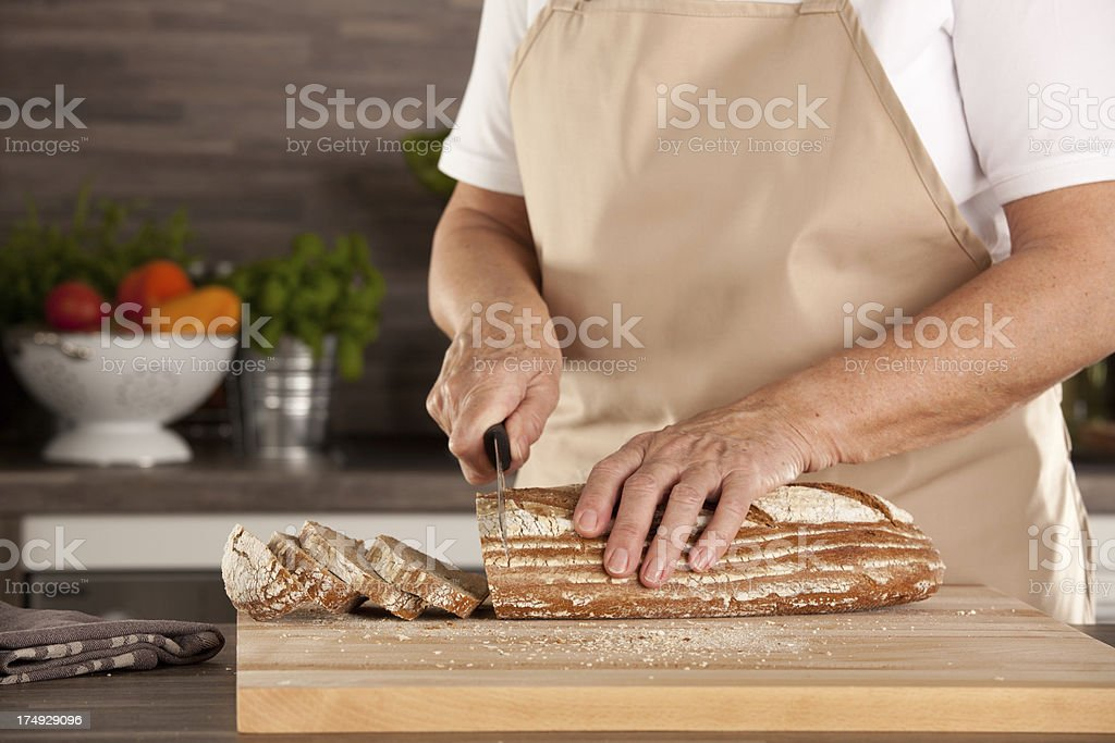 woman cutting bread royalty-free stock photo