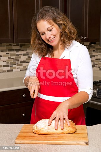 istock woman cutting bread 519750035