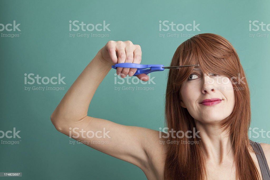 Woman Cutting Her Own Hair stock photo
