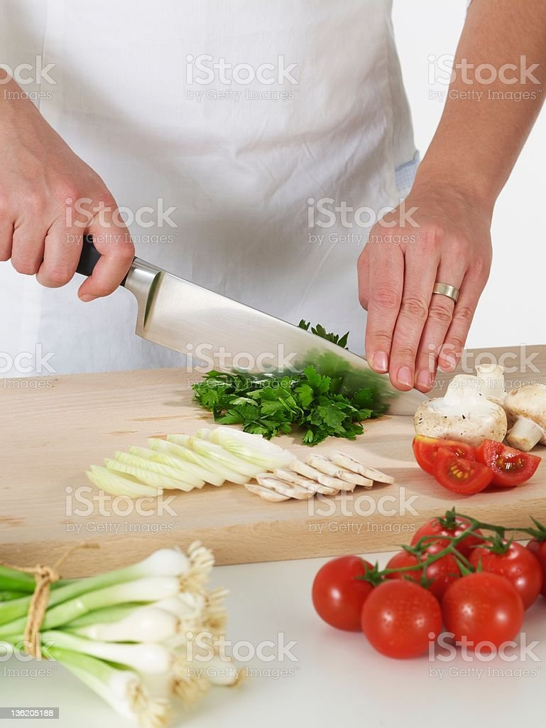 Woman cutting parsley royalty-free stock photo