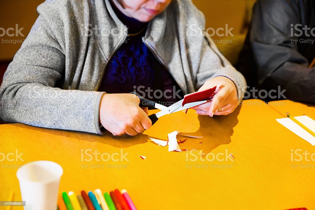 A woman enjoys an arts and crafts activity while on vacation. RM