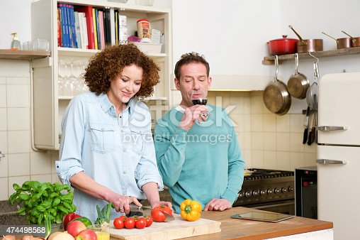 638771390istockphoto Woman cutting vegetables in the kitchen 474498568