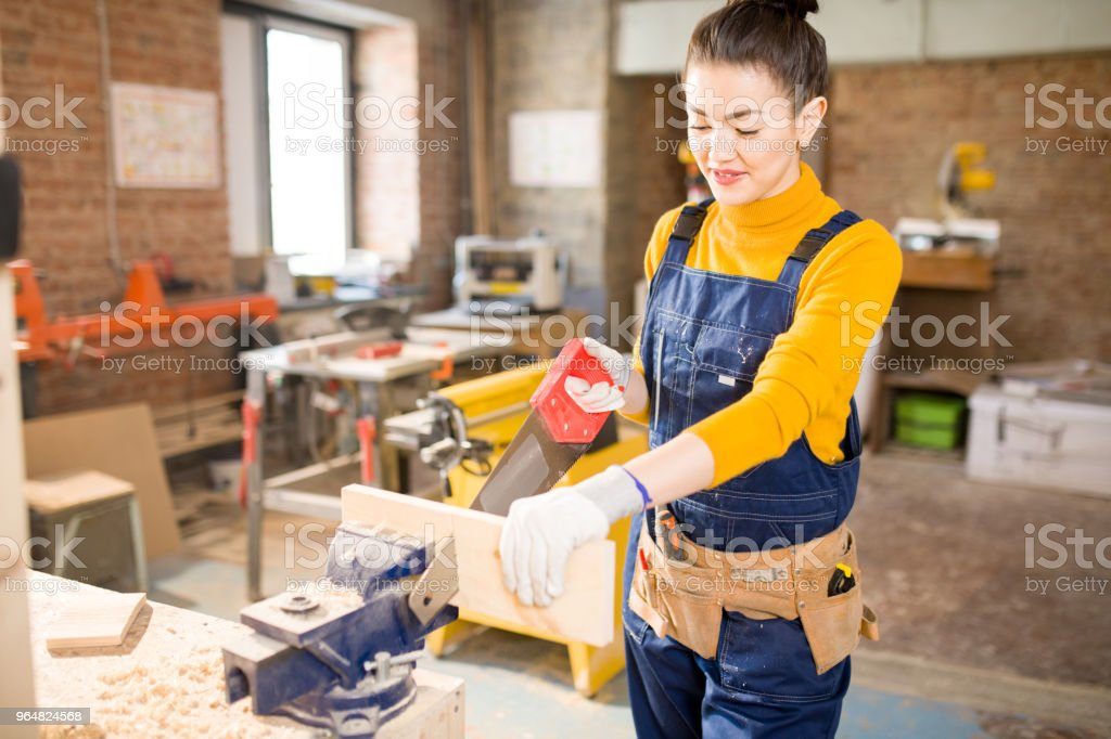 Woman Cutting Wood royalty-free stock photo