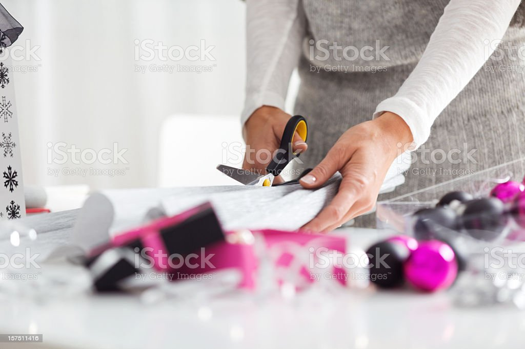 Woman Cutting Wrapping Paper royalty-free stock photo