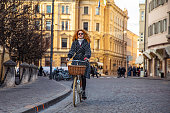Woman cycling in Milan - Italy