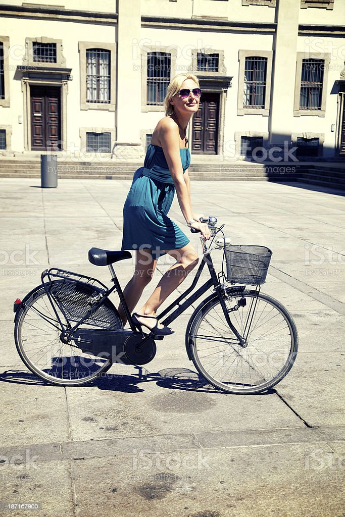 Woman cycling In Milan royalty-free stock photo