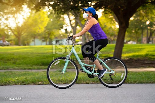 Woman cycling on the neighborhood