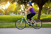 Woman cycling on the neighborhood