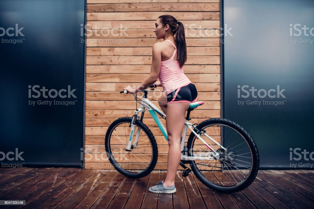 Woman cycling outdoor stock photo