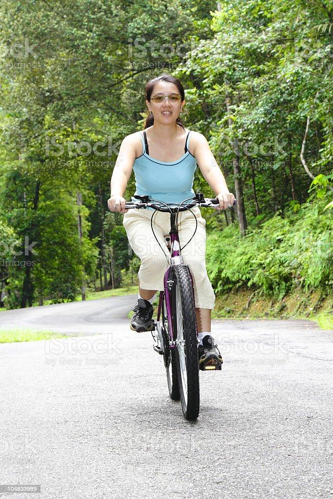 Woman cycling royalty-free stock photo