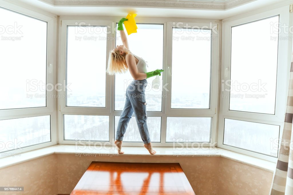 Woman dancer removes the apartment. stock photo