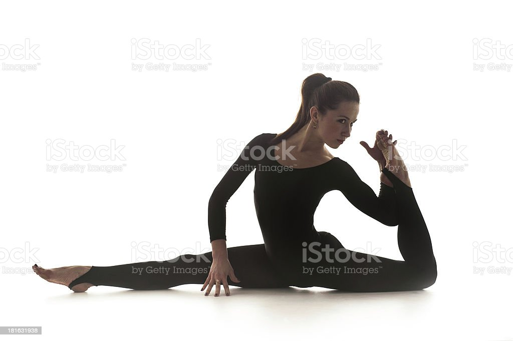 Woman dancing acrobatical dance. Isolated on white royalty-free stock photo