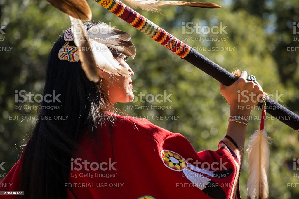 Woman dancing at the Kiowa Blackleggings Warrior Society Pow-wow. stock photo