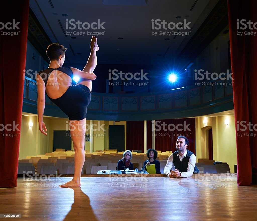 woman dancing for audition with jury in theater stock photo