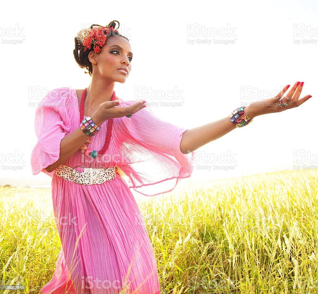 Woman Dancing In Field stock photo
