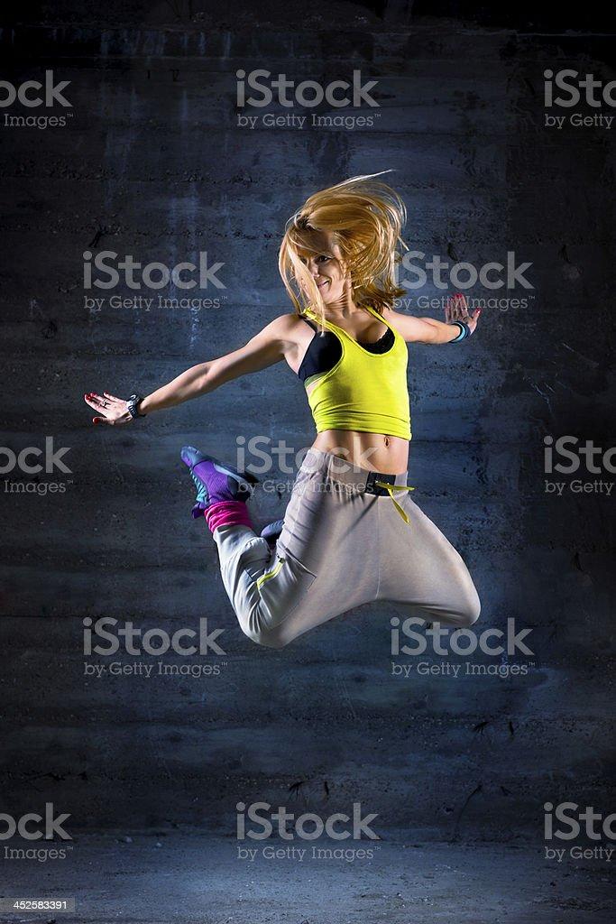 Woman dancing in urban environment stock photo