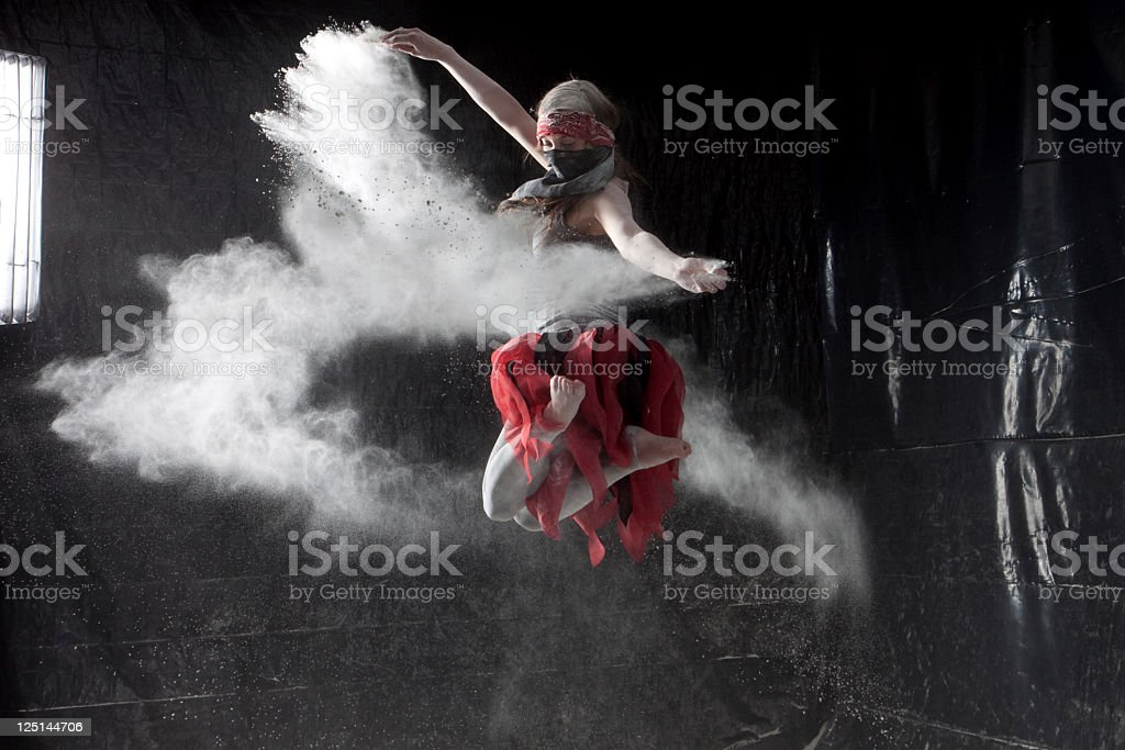 Woman Dancing in White Powder stock photo