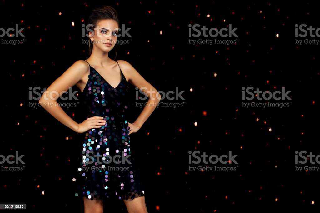 Woman dancing on a party over colorful background with confetti stock photo