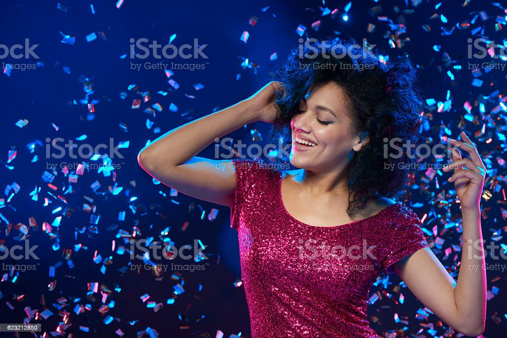 Woman dancing on a party stock photo