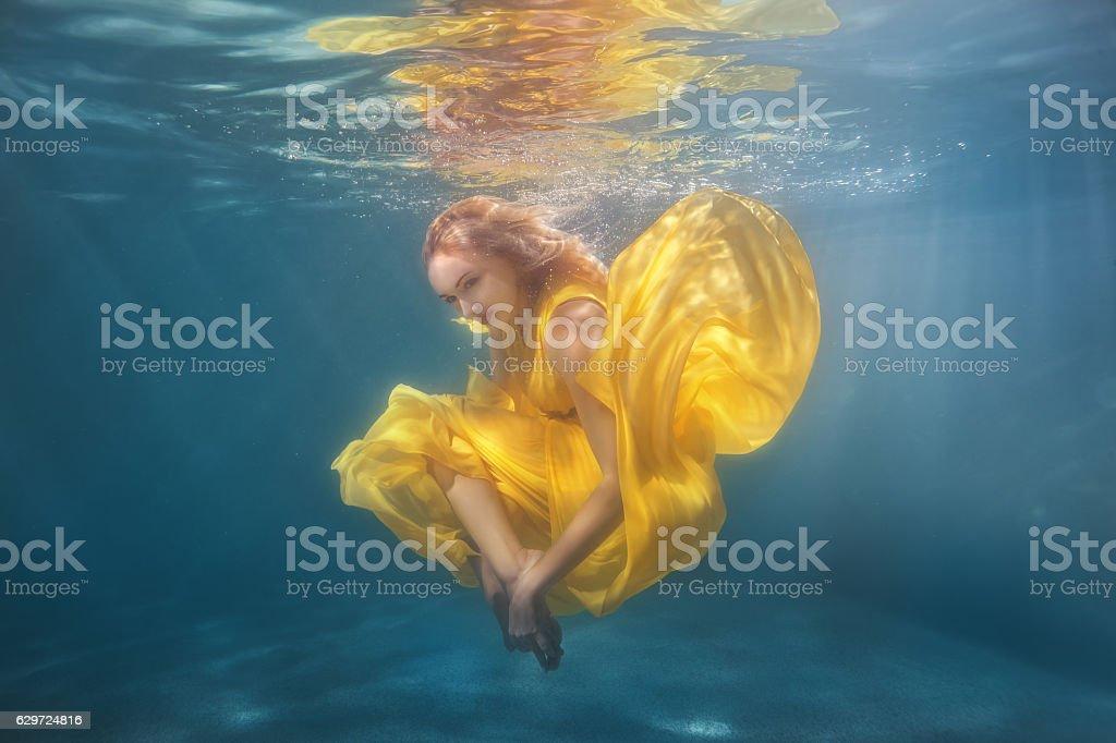 Woman dancing underwater. stock photo
