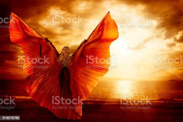 Woman dancing wings dress fashion art model flying on ocean sky picture id916076780?b=1&k=6&m=916076780&s=612x612&h=v5cc1bvngzu4yutxufssabsghyykv0mb8o804l1czvi=