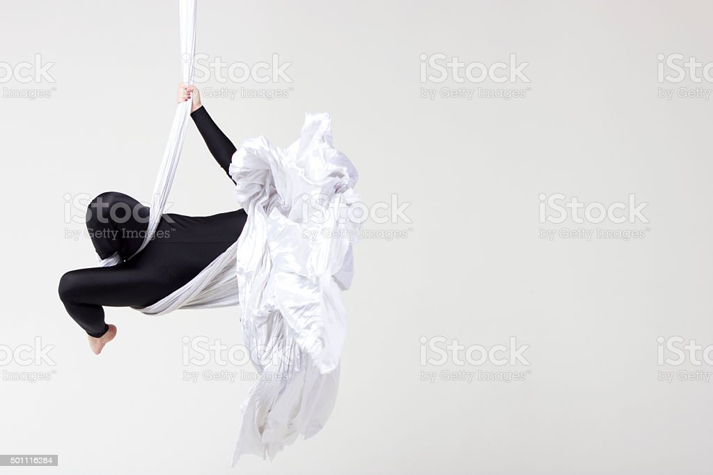 Woman dancing with aerial silks stock photo
