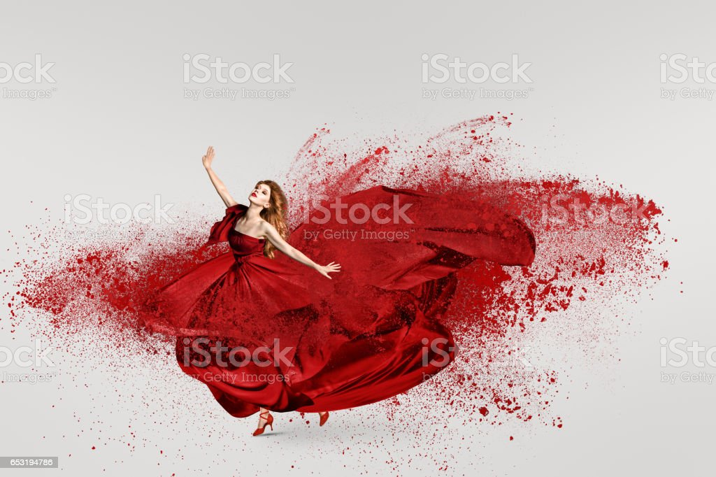 Woman dancing with cloud of powder stock photo