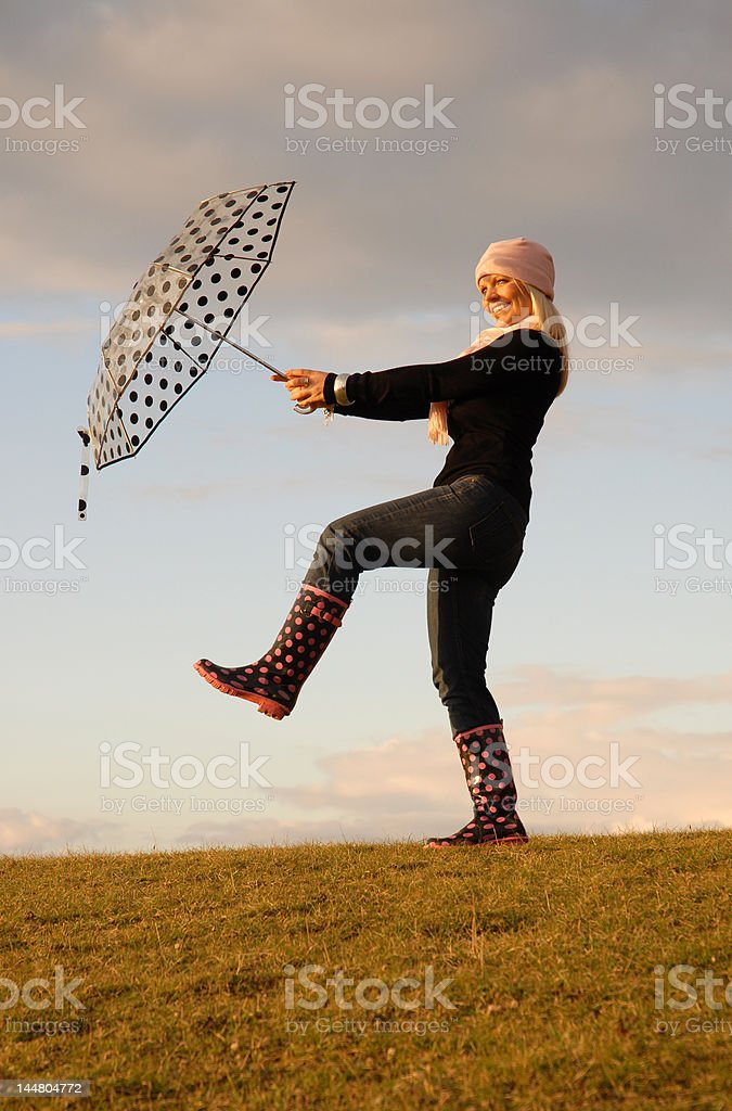 Woman dancing with umbrella. royalty-free stock photo