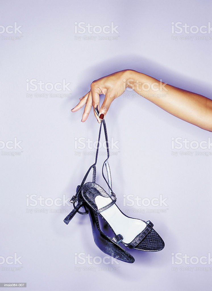 Woman dangling her shoes 免版稅 stock photo