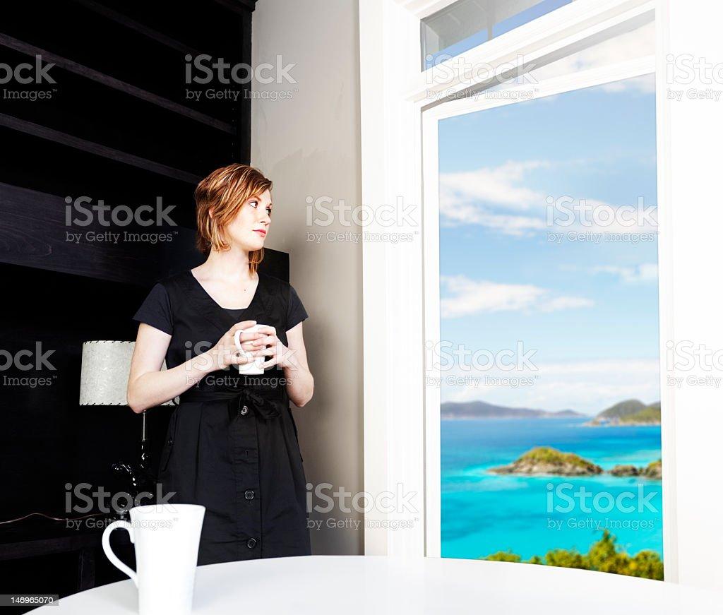 Woman daydreaming stock photo
